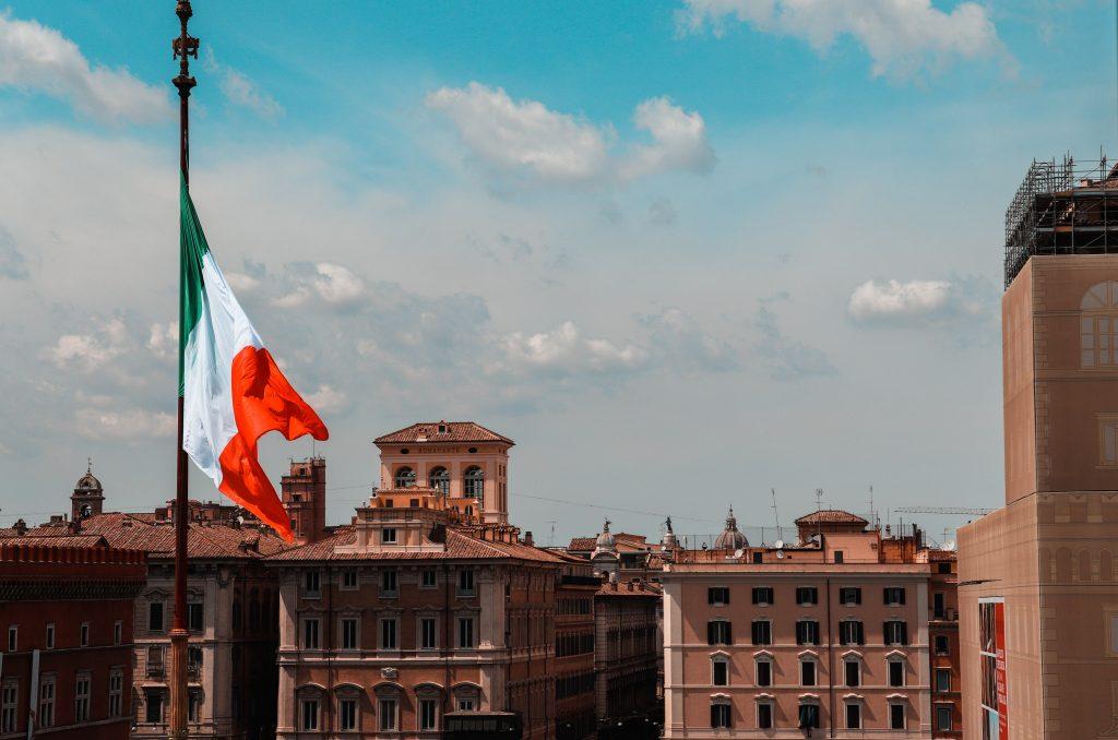 Italian flag flying over an Italian city