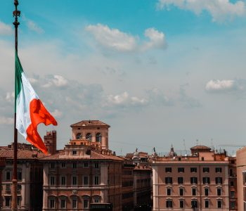 Italian flag flying over an Italian city