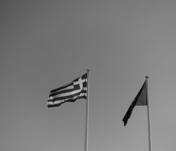 Flags of Greece and the EU in black and white