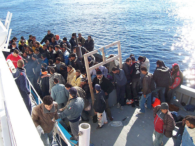 Photo of refugees on a beat in the Mediterranean